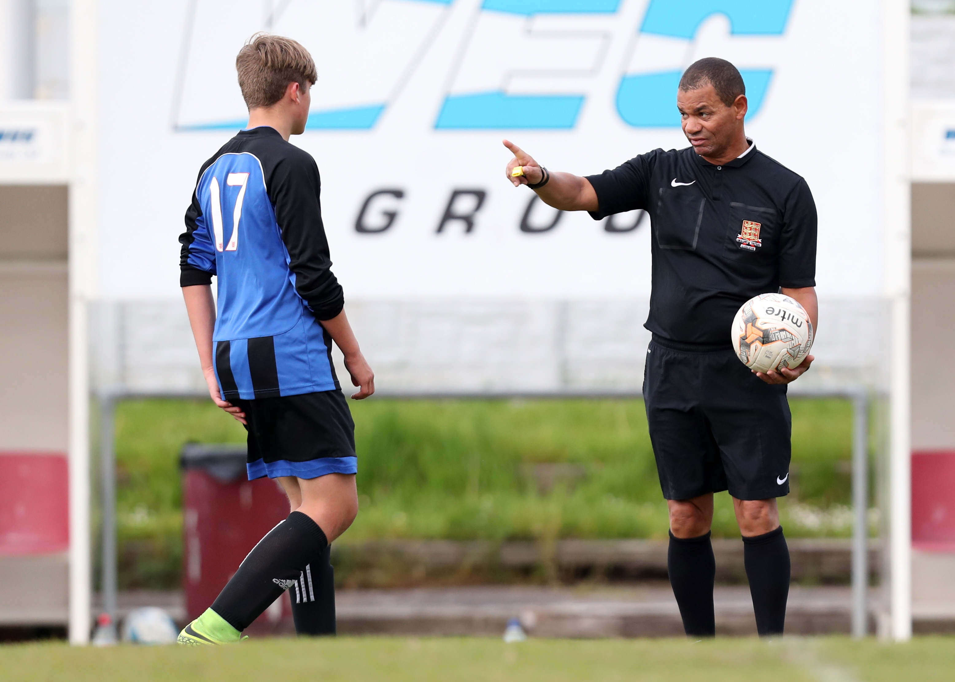 Football law changes - referee surrounding.jpg