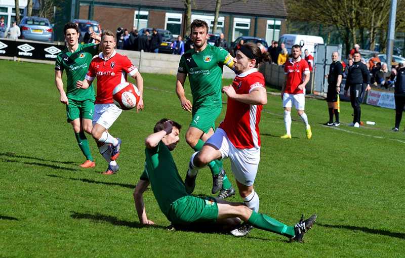 football slide tackle on player