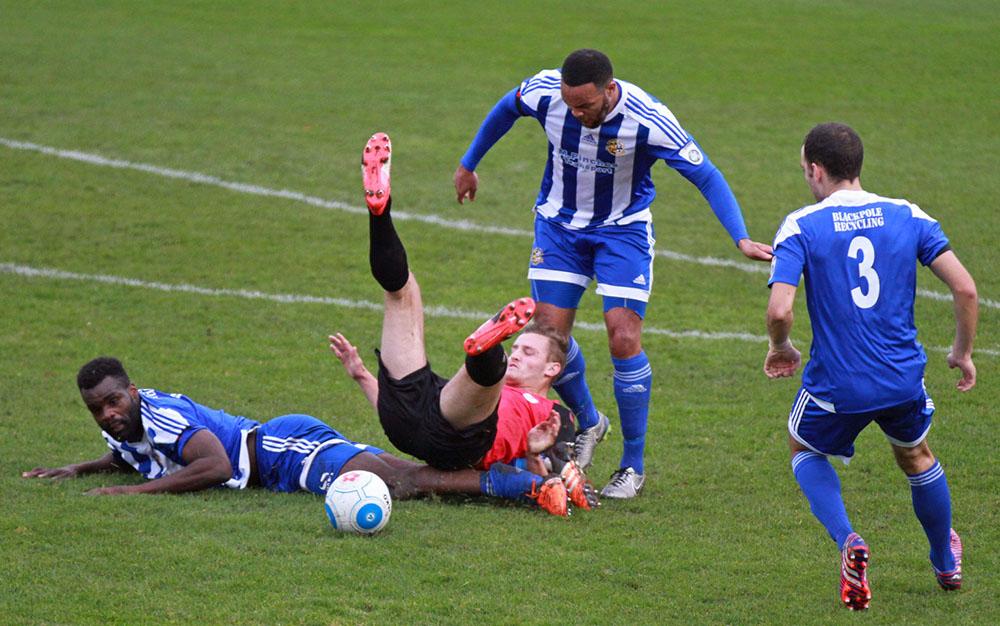 footballer slide tackles the opposition
