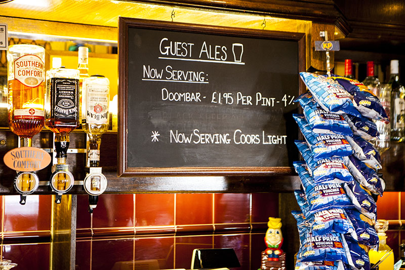 scene of a pub with drinks and special offers