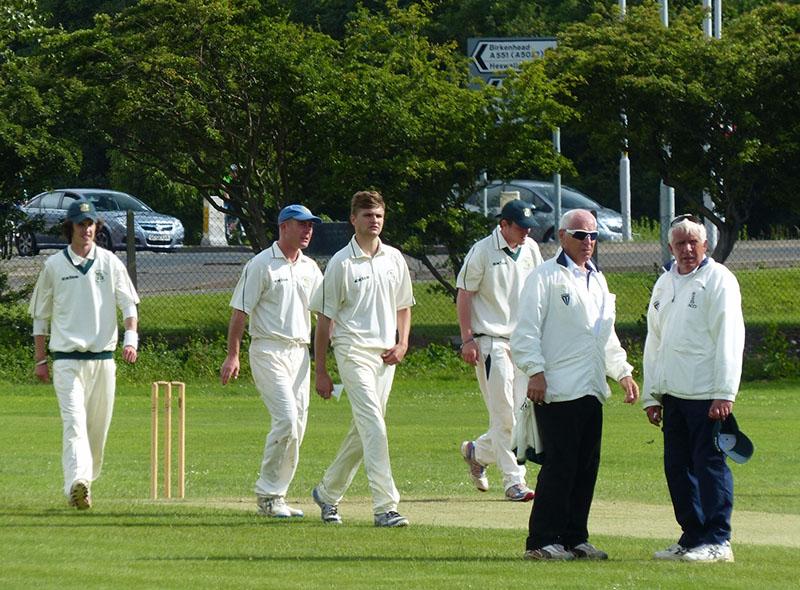 cricket umpires on a cricket field