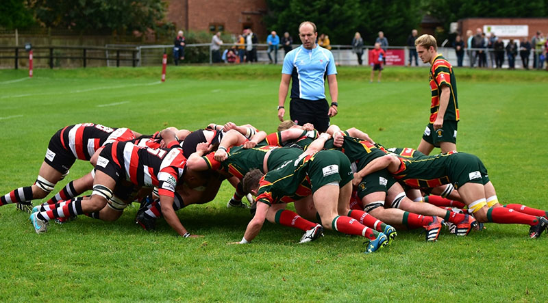 rugby referee officiating a scrum