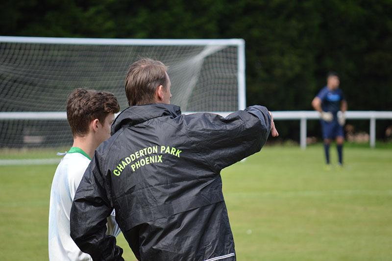football coach explains tactics to player
