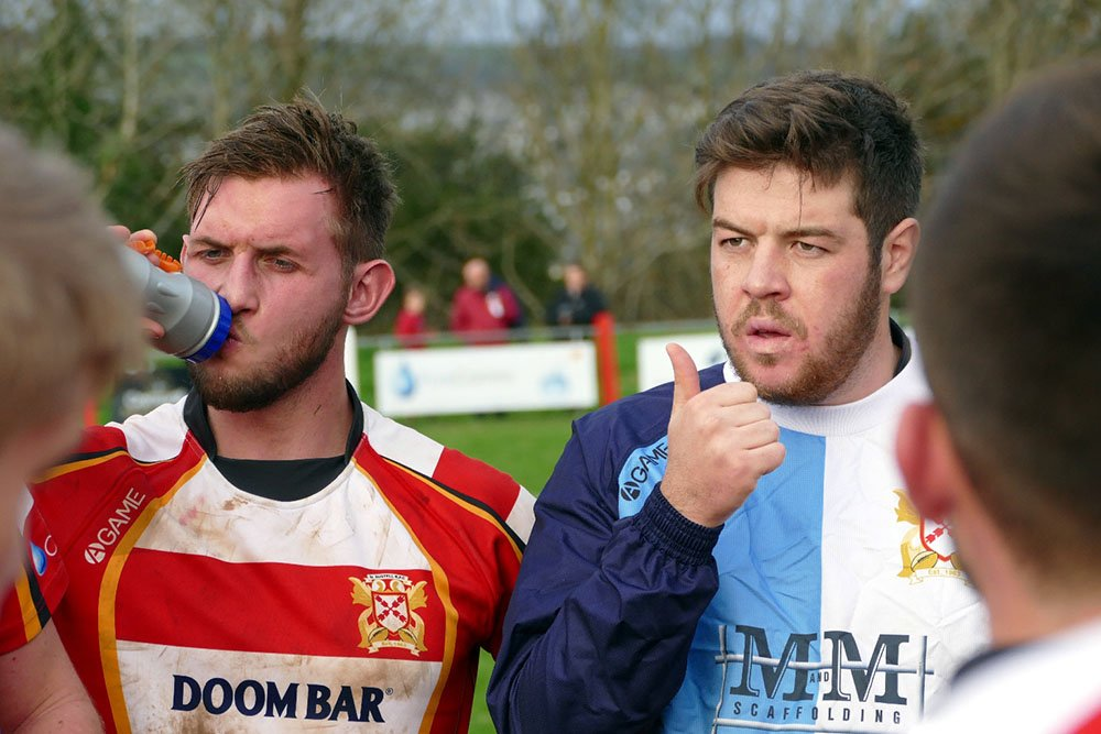 rugby player takes a drink during a match