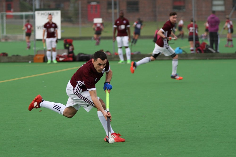hockey player sprints during a match