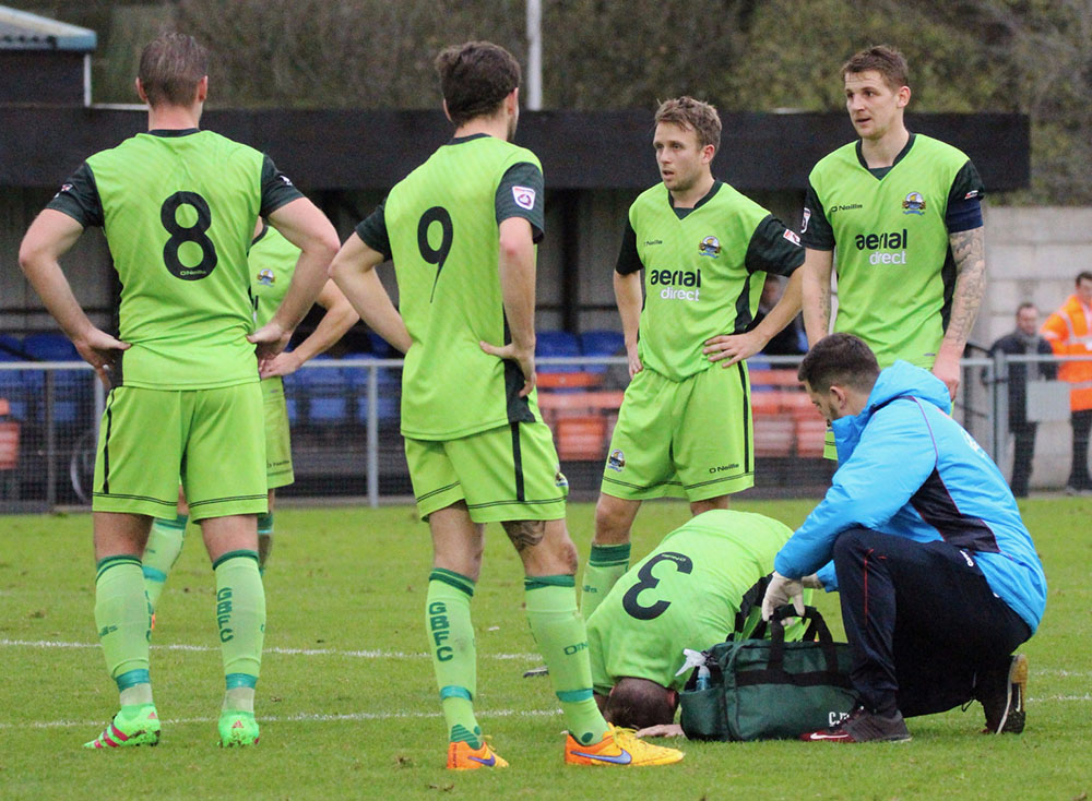 player receives treatment for injury