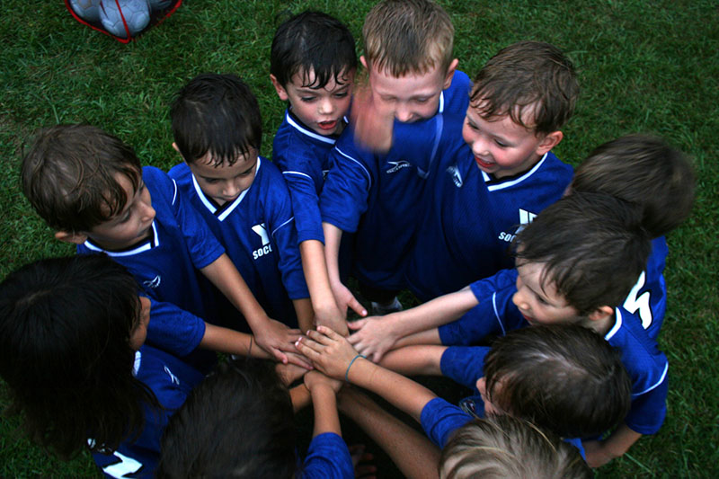 kids sports team huddle