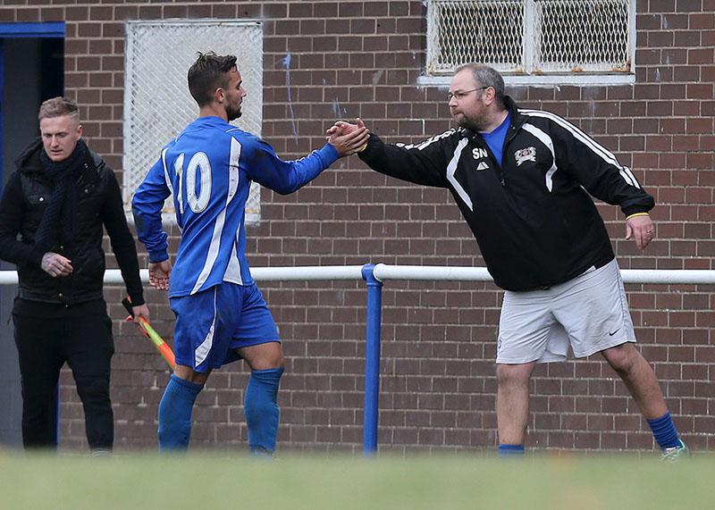football coach high fives his player