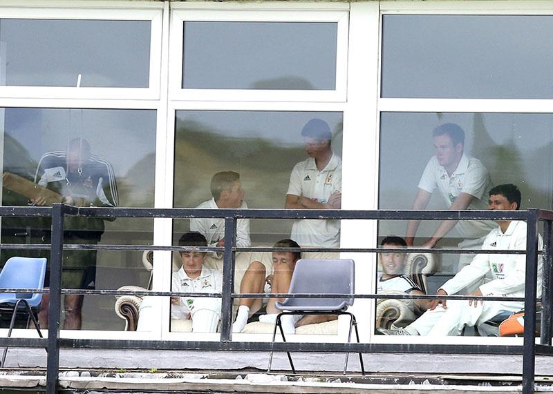 cricket team sit in dressing room