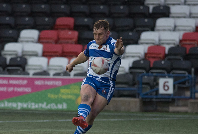 Rugby League player kicks for goal