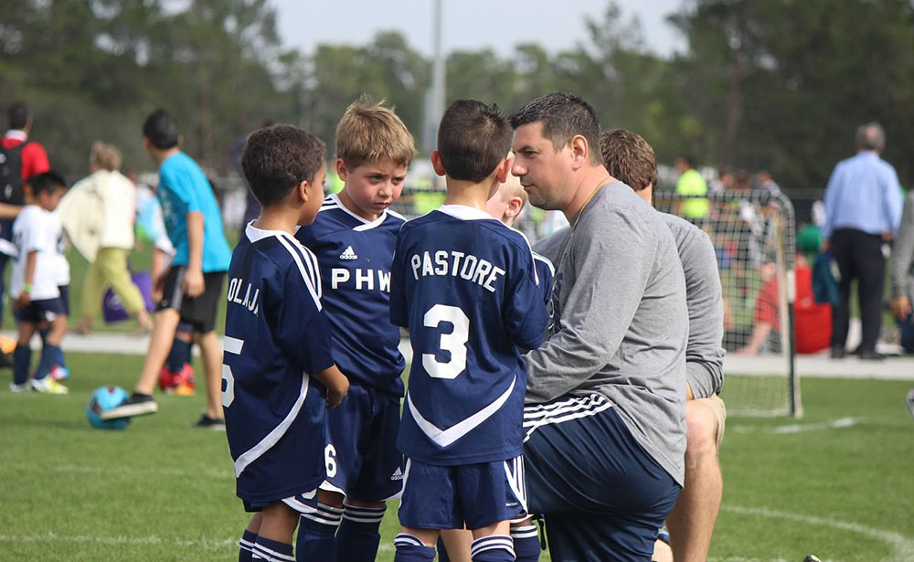 youth sports coach team huddle