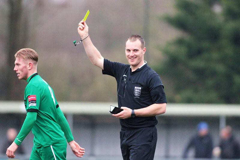 football referee gives a yellow card